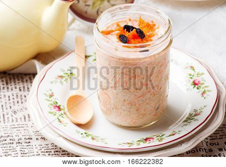 Carrot Cake Overnight Oats in to the jar.selective focus
