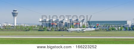 Munich Germany - May 6 2016: Passenger airliner Airbus A340 of South African Airways taxiing from Munich airport terminal to runway. Panoramic editorial stock photo.