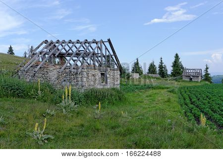 An old hut on green mountain meadow in Rila Mountain Bulgaria - the highest mountain in Bulgaria and the Balkans.