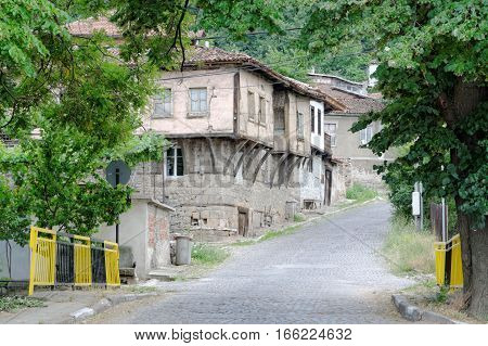 Houses in old traditional architecture in the historic town of Bratsigovo Bulgaria. Bratsigovo is a spa and arcitecture resort in the Rhodope mountain.
