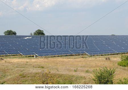 Solar panel produces green environmentally friendly energy from the sun.