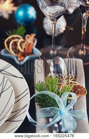 Winter table setting with Christmas decoration. Home interior.