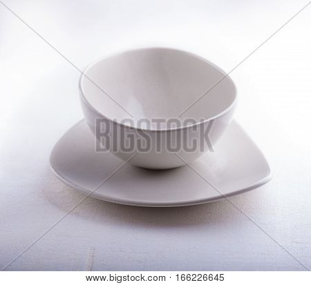 Two Empty bowls placed on a white surface.