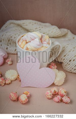 Good morning with hot chocolate on wooden table with love pink heart for valentines day concept,