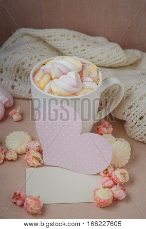 Good morning with hot chocolate on wooden table with love pink heart and blank card for valentines day concept,