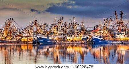 Fishing Ships During Majestic Sunset