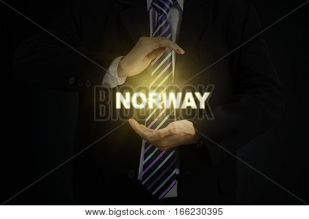 Image of male entrepreneur wearing formal suit and protecting a word of Norway