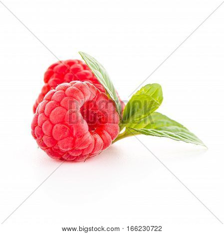 Raspberry fruits and mint isolated on white background.