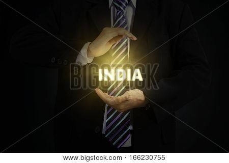 Picture of young male entrepreneur wearing formal suit while holding India word