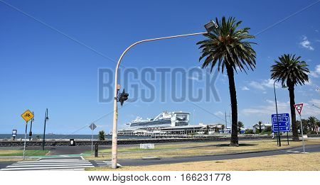 Melbourne Australia - December 30 2016. Ferry terminal building in Port Melbourne. A large luxury Cruise Liner is docked at Melbourne's Station Pier for a stop over.