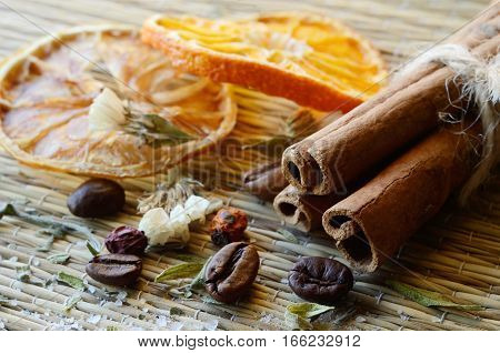 Spa still life - cinnamon, coffee beans, salt, dried orange, lemon pieces,haws and lavender leaves