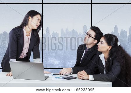 Portrait of young entrepreneur angry to her employee in business meeting at the office