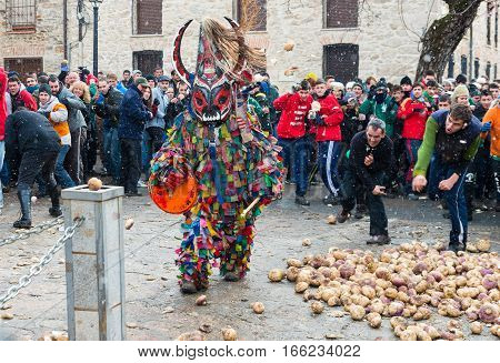 Piornal Spain Tuesday Jan. 20 2017. People throw turnips at the Jarramplas as he makes his way through the streets beating his drum during the Jarramplas Festival in Piornal