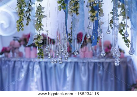 Decorationof the banquet hall at a wedding ceremony in the evening light