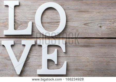 Love and still life concept. Valentines day holiday letters text message card. Top view flat lay overhead, copy space background