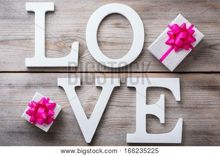Love and still life concept. Valentines day holiday letters text message card with gift boxes. Top view flat lay overhead