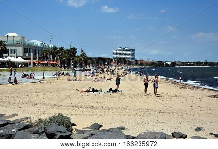 St Kilda Australia - December 30 2016. Hot sunny day in summertime on St Kilda beach. St Kilda beach in Melbourne is a popular place for swimming in the sea.