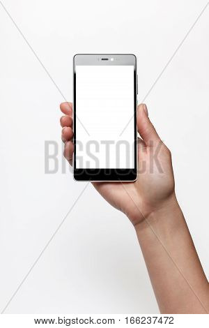 Female hand holding smartphone with blank screen. Screen isolated with clipping paths
