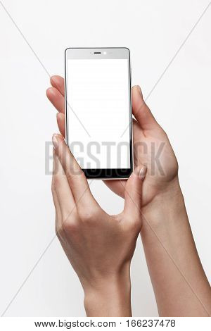 Female hands holding smartphone with blank screen. Touchscreen isolated with clipping paths