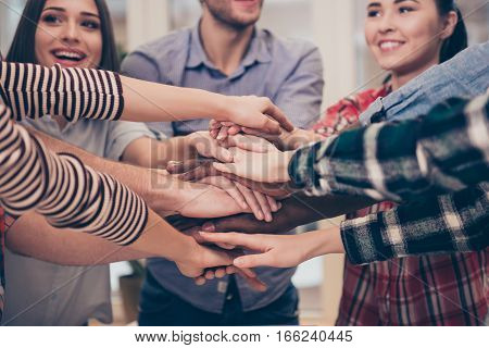 Close Up Of Young Happy Multiethnic Business Team Holding Hands Together
