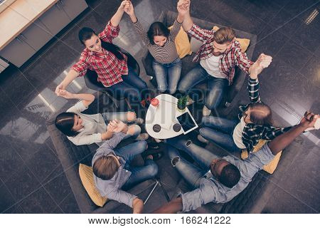 Partnership And Teambuilding. Group Of Business People With Raised Hands
