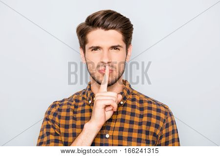 Young Handsome Guy In Checkered Shirt Showing Silent Gesture
