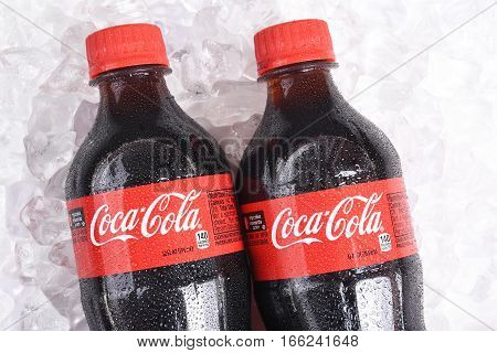 IRVINE CALIFORNIA - January 22 2017: Two bottles of Coca-Cola on ice. Coca-Cola is the one of the worlds favorite carbonated beverages.