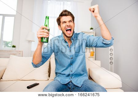 Young Excited Happy Man Watching Footbal At Home