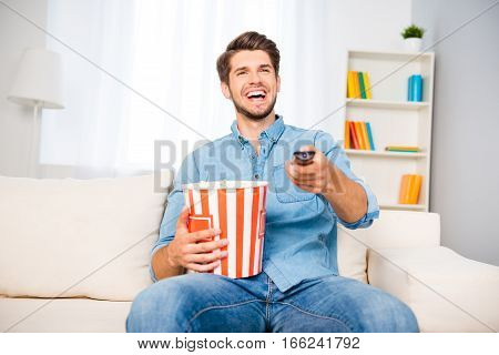 Laughing Man Watching Comedy And Eating Popcorn