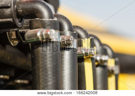 Industrial detailed pneumatic hydraulic machinery concept. Pump made of steel on machine closeup.