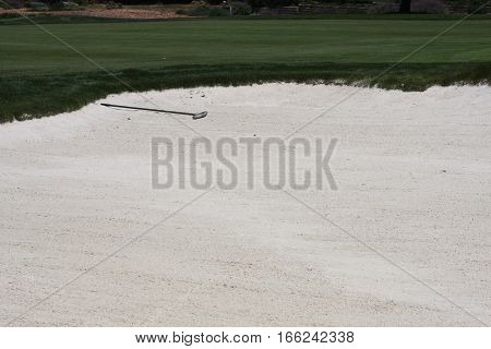 This is an image of a new fairway sand trap with white sand taken on a sunny moring.