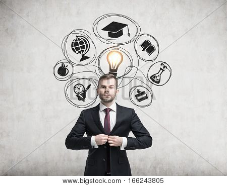 Businessman buttoning his suit is standing near a concrete wall with education icons and a light bulb