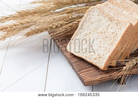 Slice Wheat Bread On White Wood Background