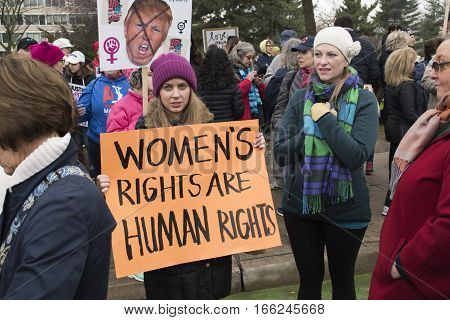 PHILADELPHIA, PA - JAN 21 2017: Women's March on Philadelphia. A sister march of Women's March on Washington. Women and men gathering in peaceful protest on Benjamin Franklin Parkway. women's rights are human rights sign.