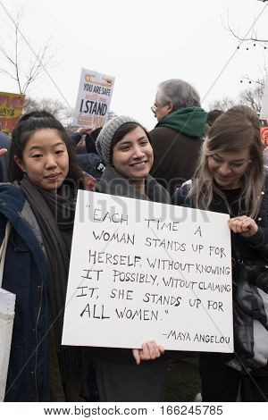 PHILADELPHIA, PA - JAN 21 2017: Women's March on Philadelphia. A sister march of Women's March on Washington. Women and men gathering in peaceful protest on Benjamin Franklin Parkway. Maya Angelou quote on sign.