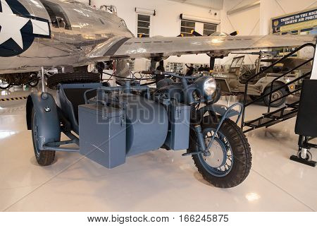 Santa Ana CA USA - January 21 2017: Grey 1943 BMW motorcycle and sidecar displayed at the Lyon Air Museum in El Santa Ana California United States. It was used during World War II. Editorial use only.