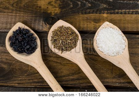 wooden spoons with spice on the table