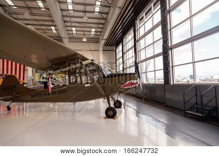 Santa Ana CA USA - January 21 2017: Army green Cessna O-1E airplane called birddog with a mouth with teeth displayed at the Lyon Air Museum in El Santa Ana California United States. It was used during World War II. Editorial use only.