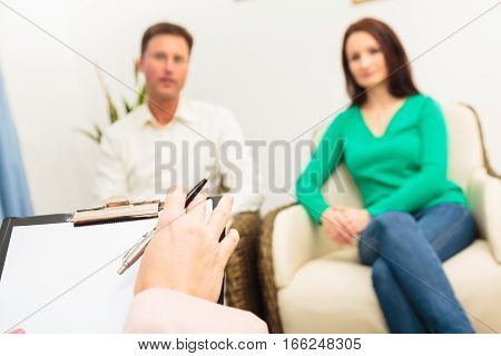 A couple is talking to a psychotherapist
