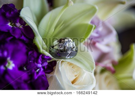 Wedding ring bands inside a lillie flowers