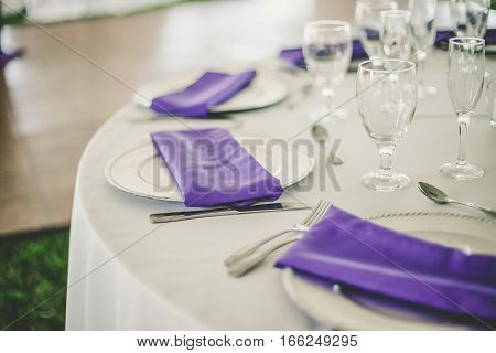 Wedding reception table set up in purple and white