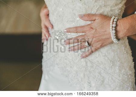 Detail photos of Bride getting ready in her wedding dress