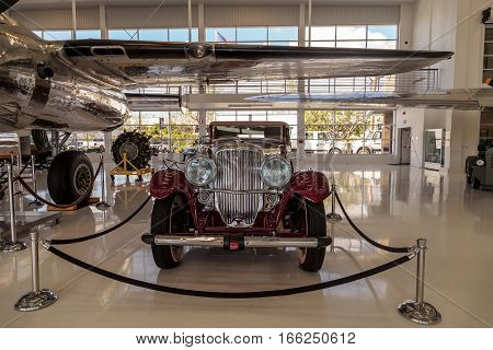 Santa Ana CA USA - January 21 2017: Red 1935 Duesenberg Model J displayed at the Lyon Air Museum in Santa Ana California United States. It was used during World War II. Editorial use only.