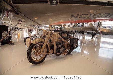 Santa Ana CA USA - January 21 2017: Tan Zundapp motorcycle displayed at the Lyon Air Museum in Santa Ana California United States. It was used during World War II. Editorial use only.