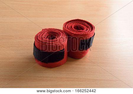 boxer wrist wraps on a wooden background