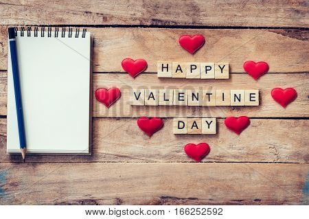 Blank Notebook And Wood Text For Happy Valentine Day With Red Heart On Wood Background.