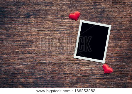 Blank Photo Frame And Red Heart On Wood Background With Space.