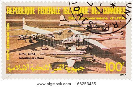 MOSCOW RUSSIA - January 20 2017: A stamp printed in Comoros shows aircrafts DC-4 DC-6 Nord Noratlas De Havilland Heron series