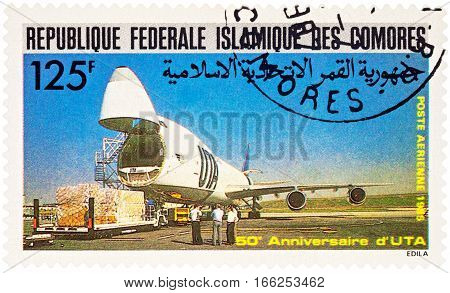 MOSCOW RUSSIA - January 22 2017: A stamp printed in Comoros shows Loading a large aircraft with wooden boards series