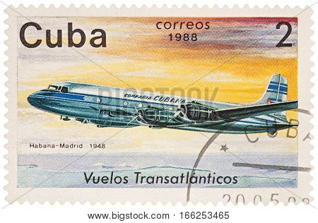 MOSCOW RUSSIA - January 17 2017: A stamp printed in Cuba shows passenger airliner Douglas DC-4 Flight Havana-Madrid (1948) series
